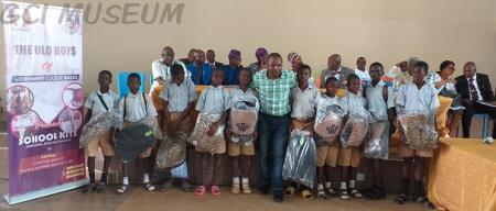 Like Minds Presents School Kits to GCI Boys.